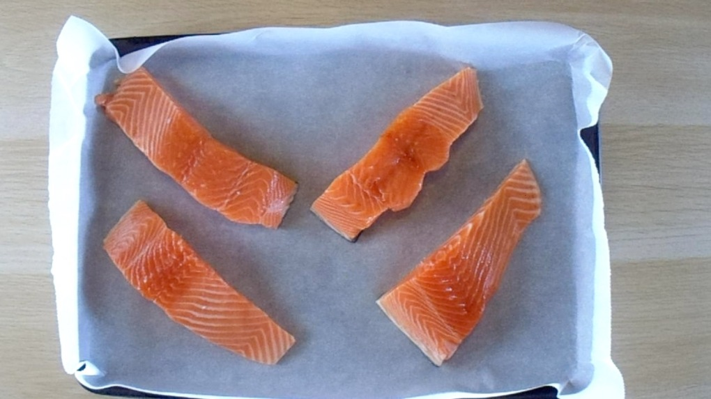 Place the salmon steak on a lined baking tray