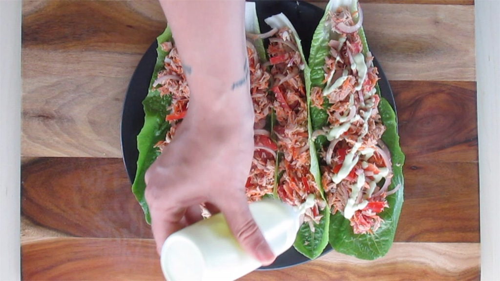 Drizzle some dressing over each wrap.