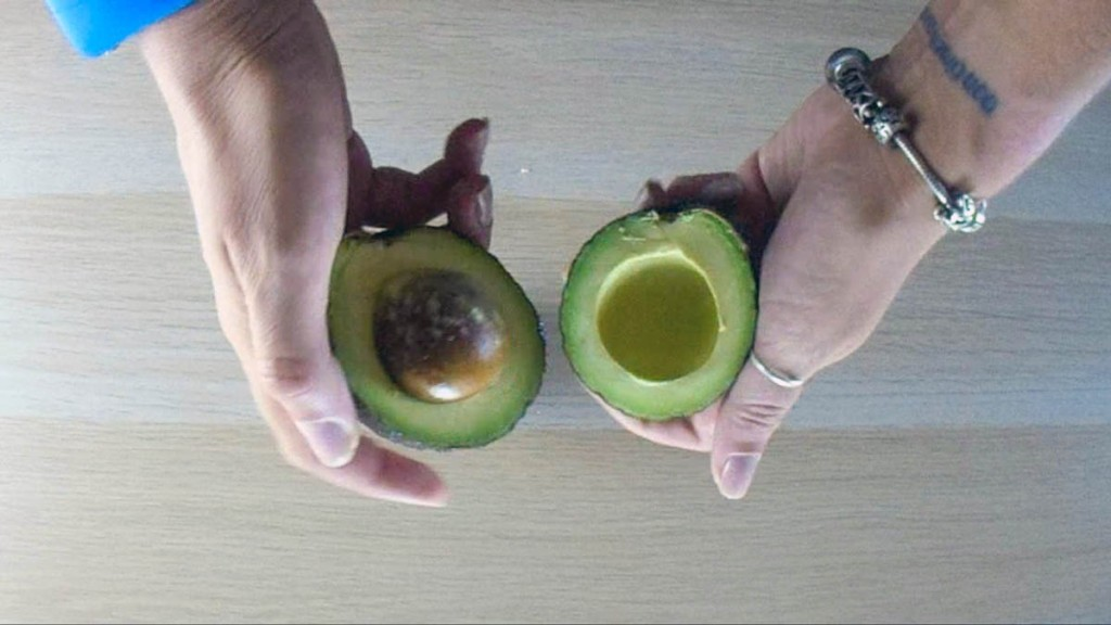 Cut the avocado in half lengthwise