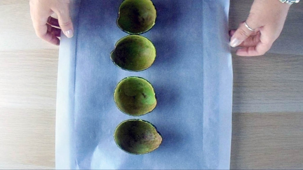 Put the avocado skins on a lined baking tray.