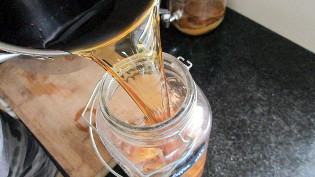 When the tea is at room temperature pour it into a jar or container