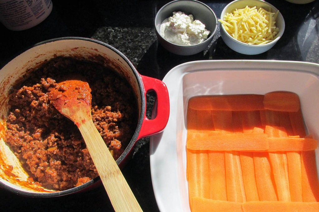 Start with a layer of carrot ribbons at the bottom of the baking dish.
