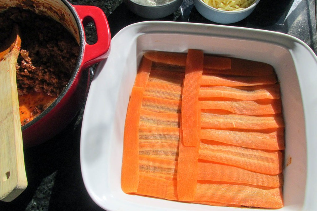 Add another layer of carrot ribbons on top of the meat.