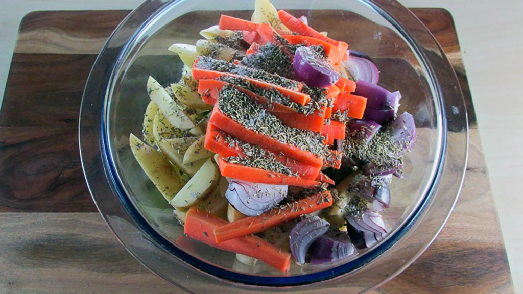 In a large bowl combine the apple, potatoes, carrots and onion with the sage and rosemary.