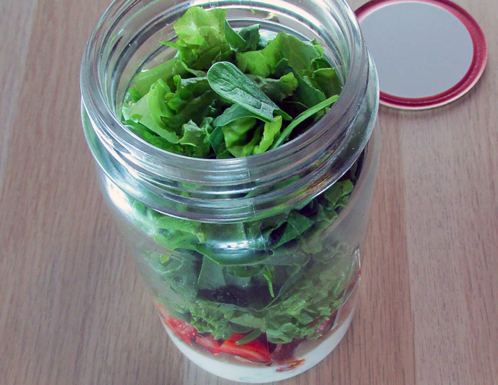 Finally add the lettuce to the jar