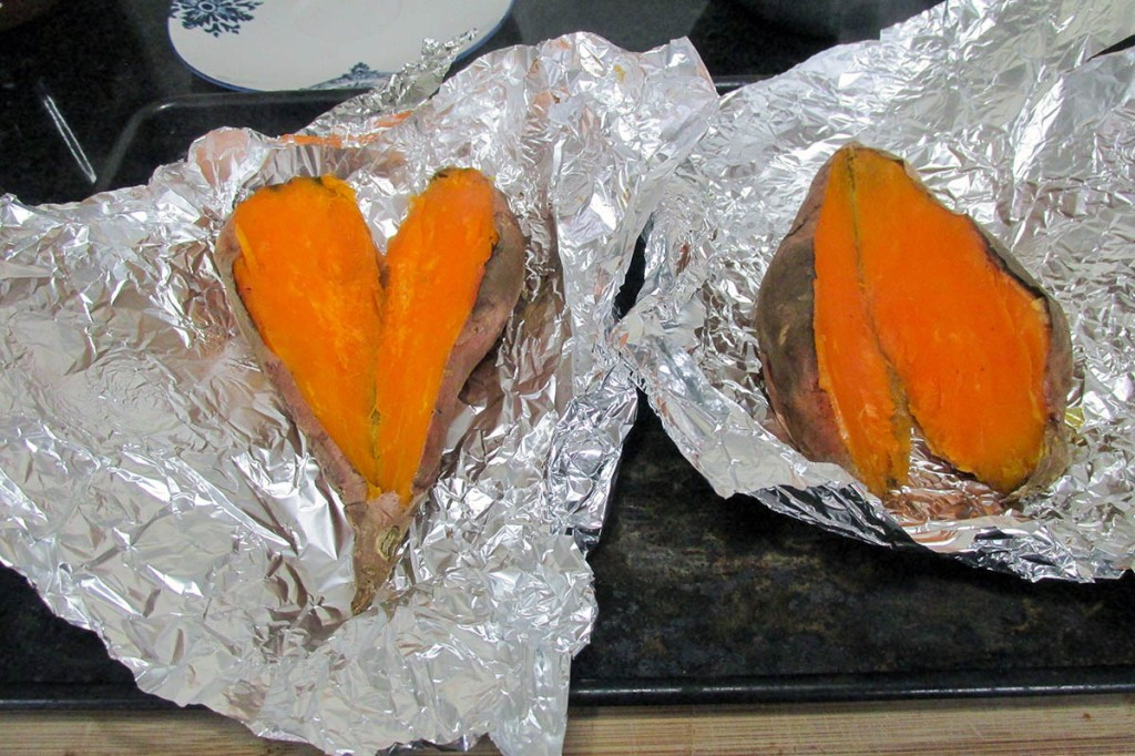 Split the baked sweet potatoes lengthwise and use a fork to mash the flesh slightly.