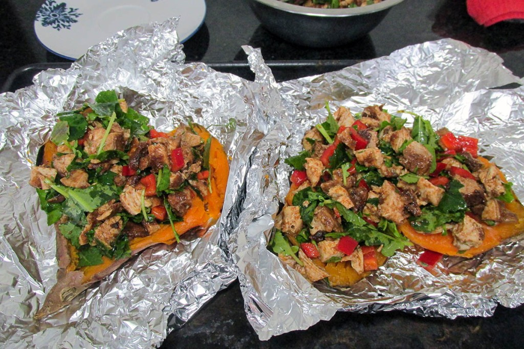 Add the chicken and kale mixture to the inside of the baked sweet potatoes.