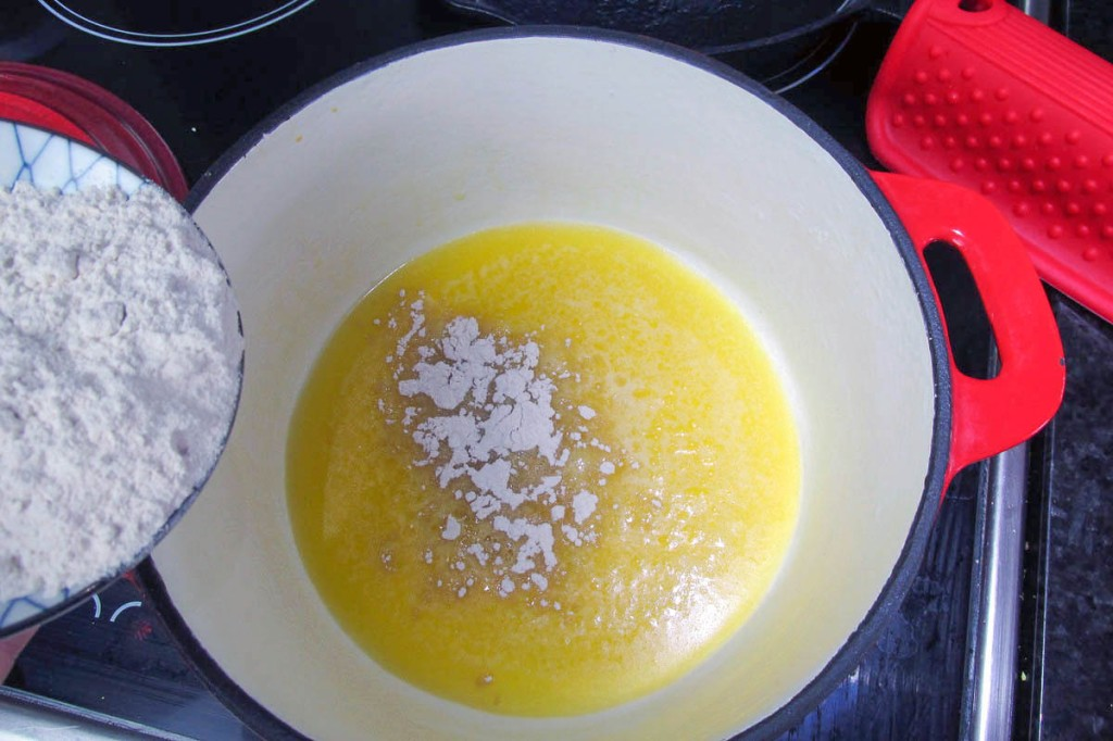 Whisk the flour into the butter to form a paste.