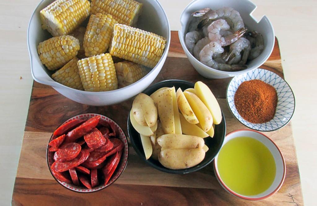 One tray Cajun prawn and sausage bake ingredients