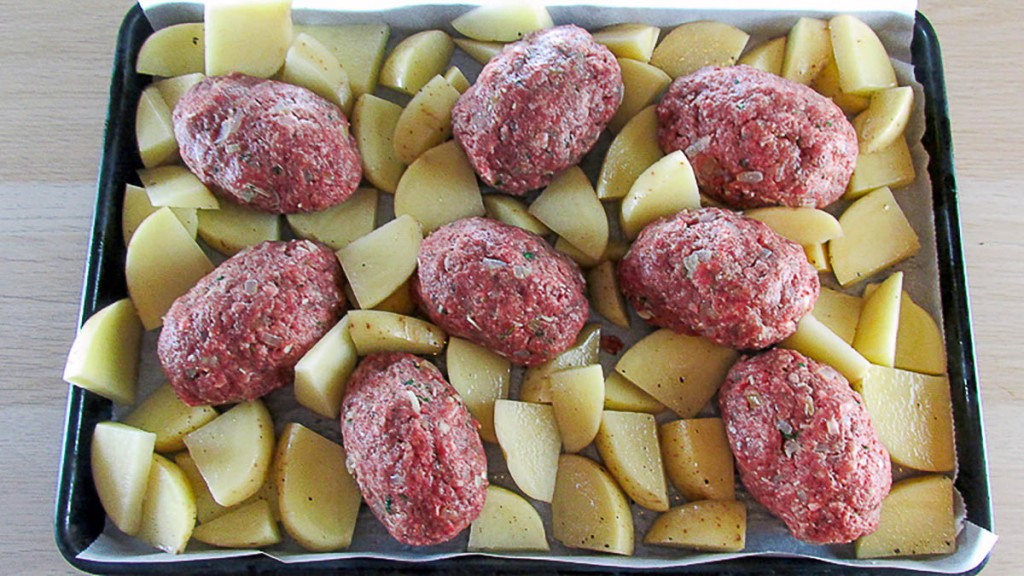 One tray mini meatloaf with potatoes ready for the oven