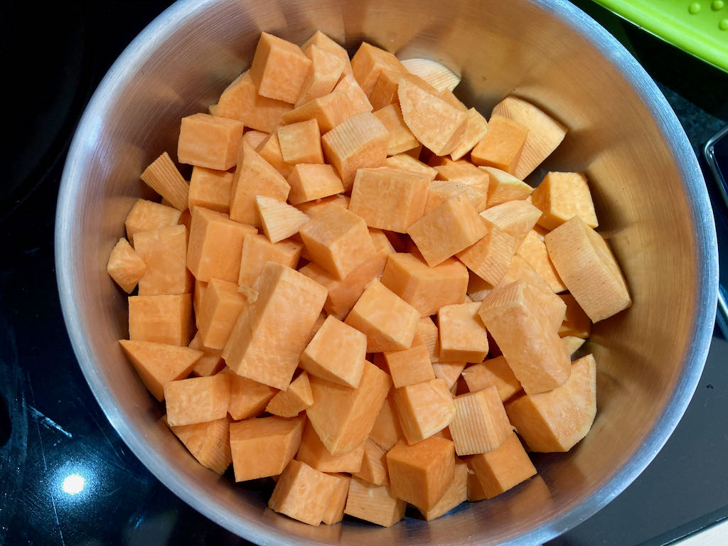 Add the diced sweet potato to a saucepan