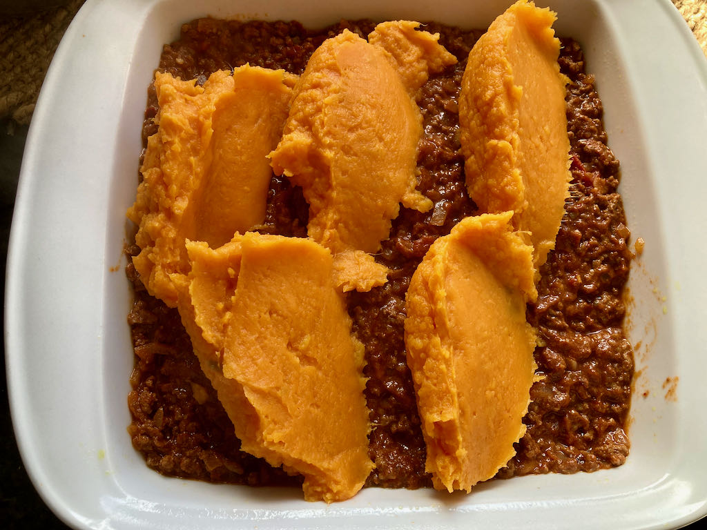Add the sweet potato on top of the meat.