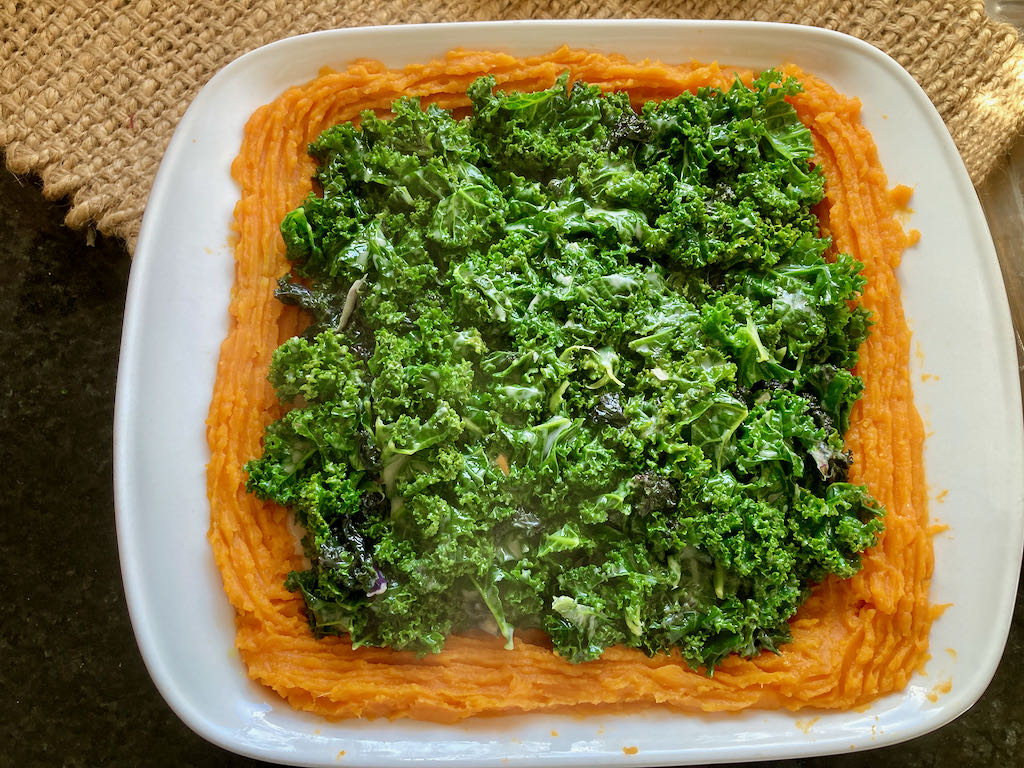 Add the creamed kale to the baking dish